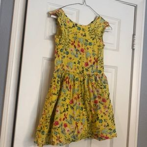 Knee-length dress. Yellow with pink/blue flowers.